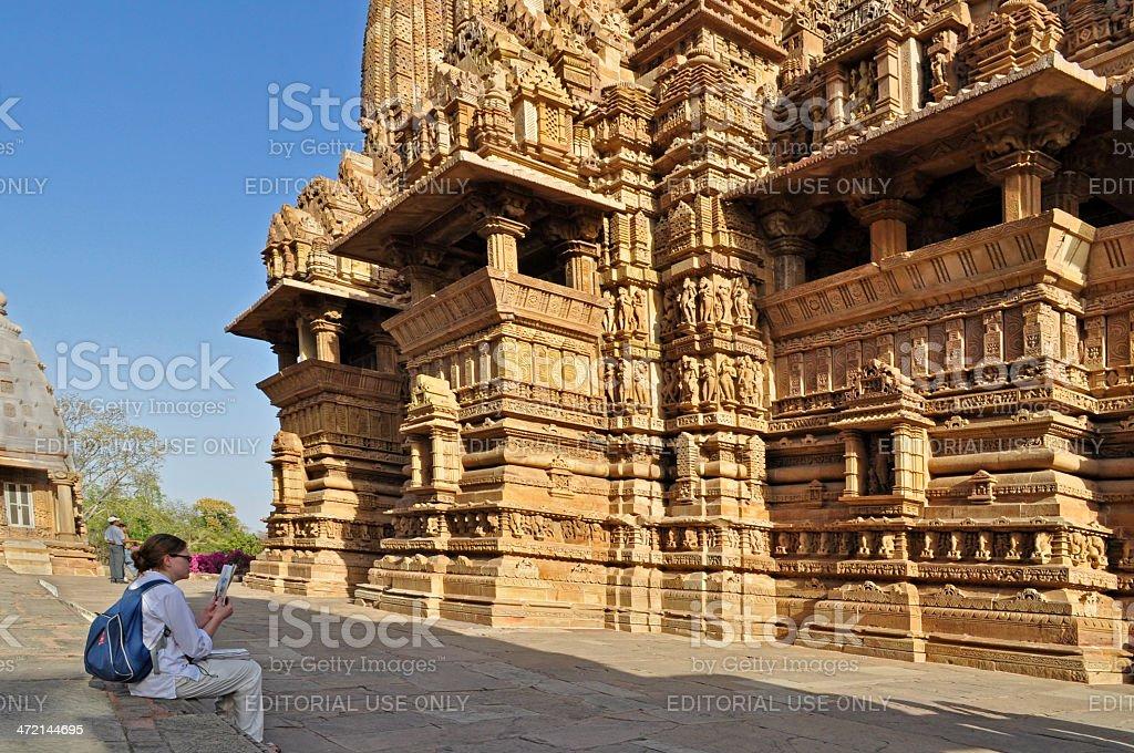 Foreign visitor studying , Khajuraho, India, UNESCO site. stock photo
