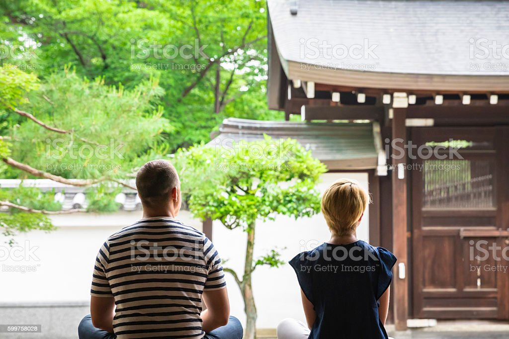 2 foreigners to the meditation in the Japanese temple stock photo