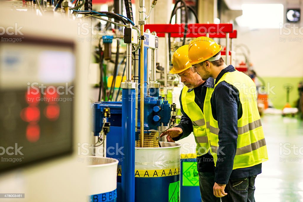 Foreman and Worker in the Factory stock photo