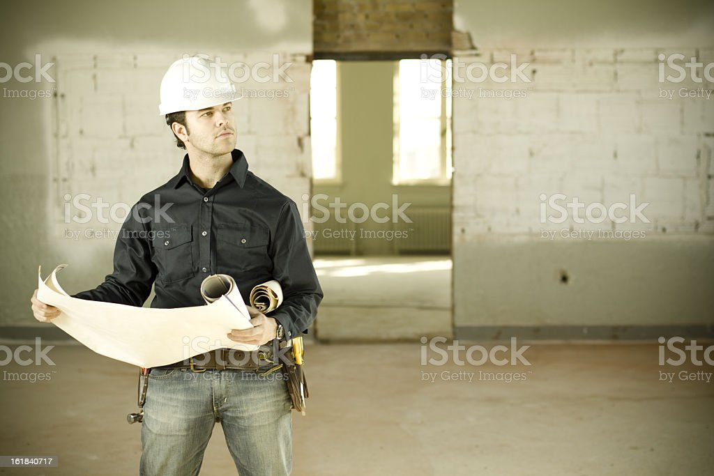 Foreman checking on progress royalty-free stock photo