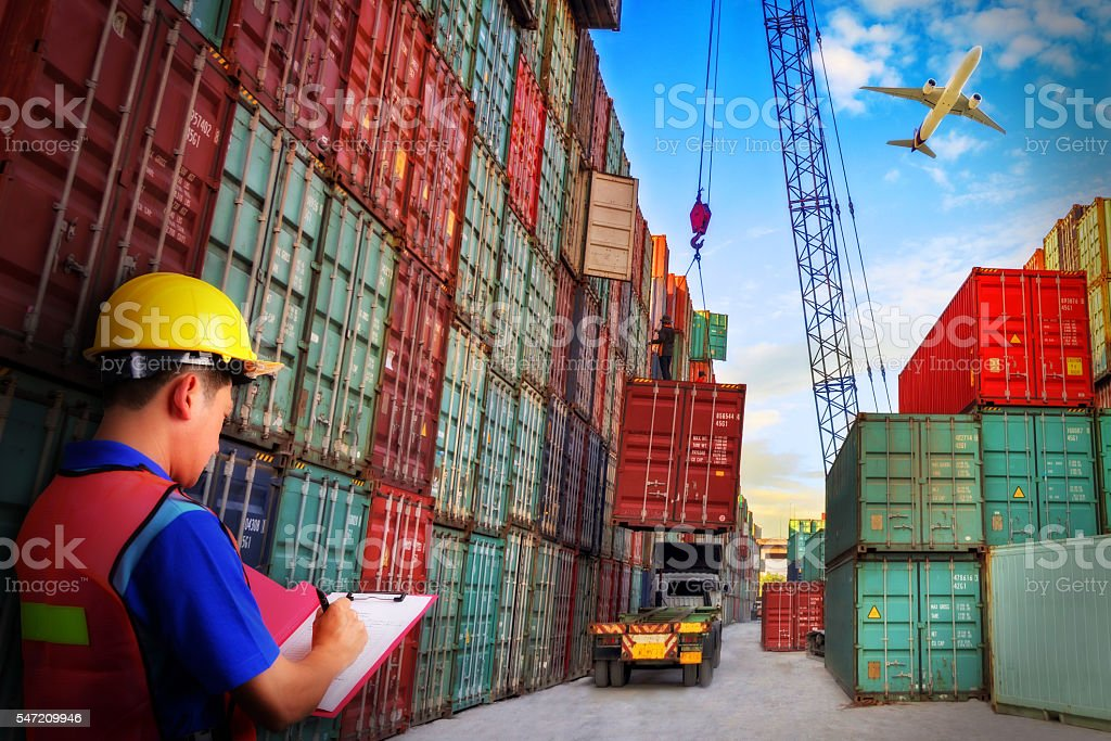 Foreman control loading Containers box to truck stock photo