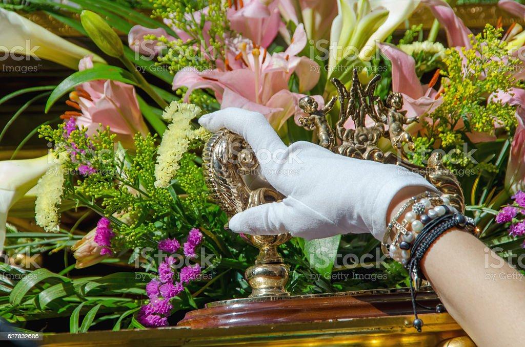 Foreman hand with a white glove inholy week procession stock photo