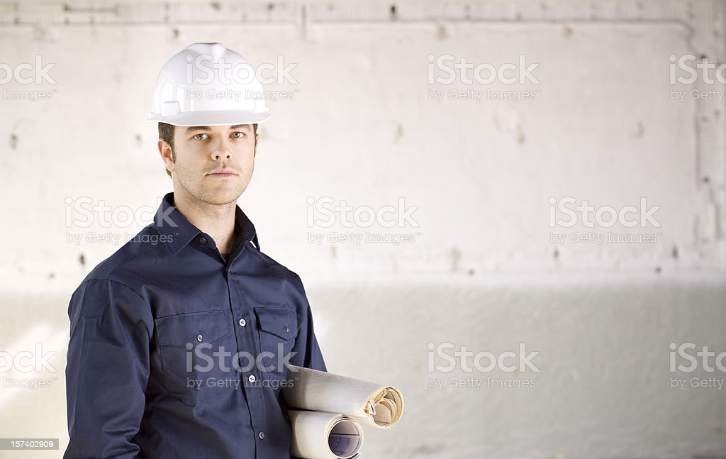 Foreman holding blueprints stock photo