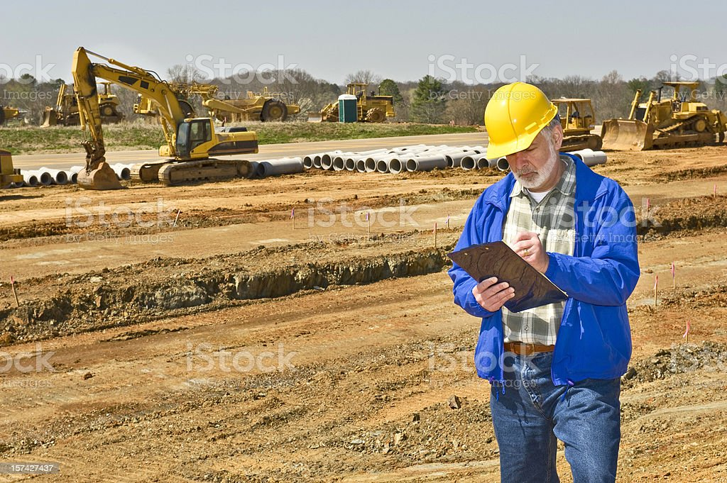 Foreman Keeping Records on Highway Construction Project royalty-free stock photo