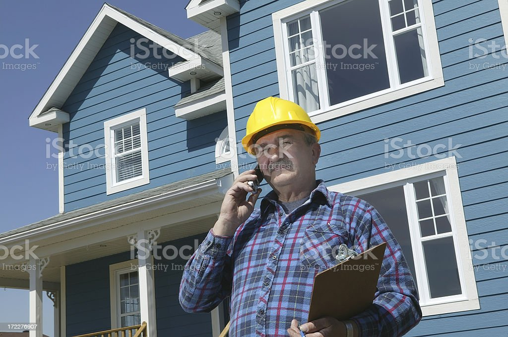 foreman over the phone royalty-free stock photo
