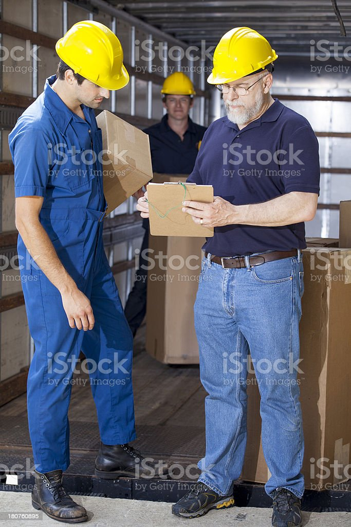 Foreman recieving packages from the truck royalty-free stock photo