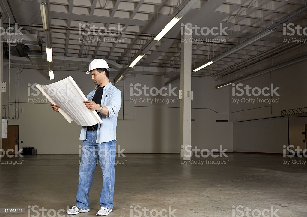 foreman with plans royalty-free stock photo