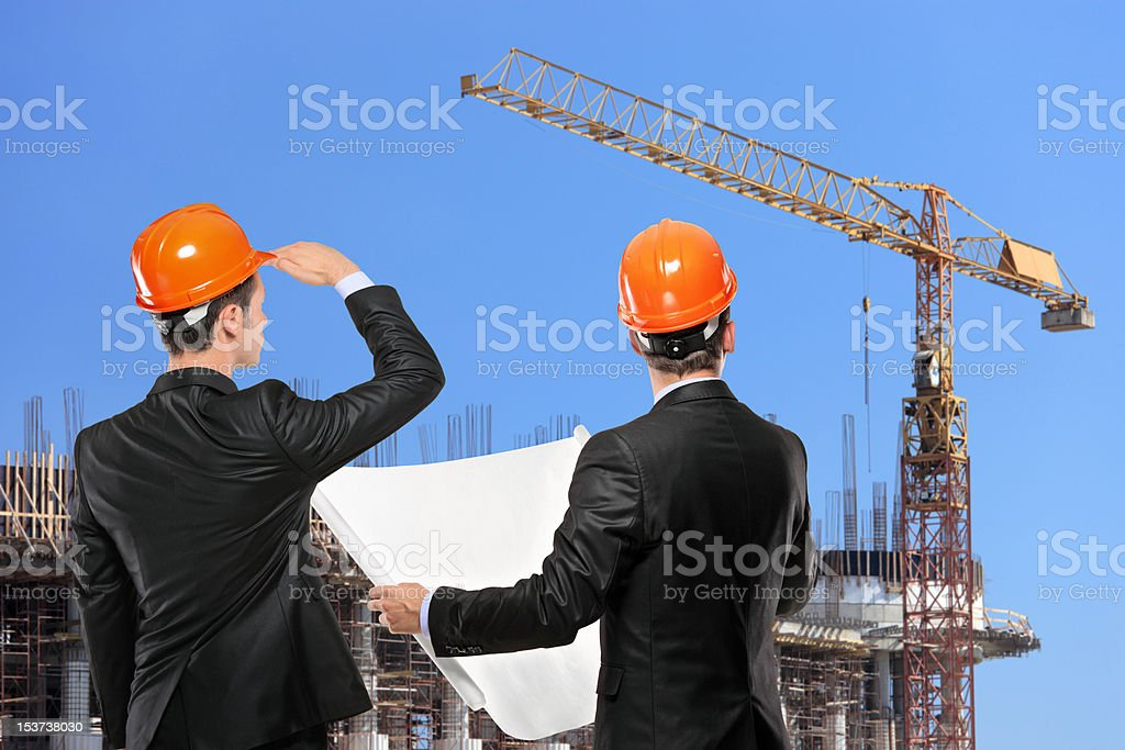Foremen looking at construction site royalty-free stock photo