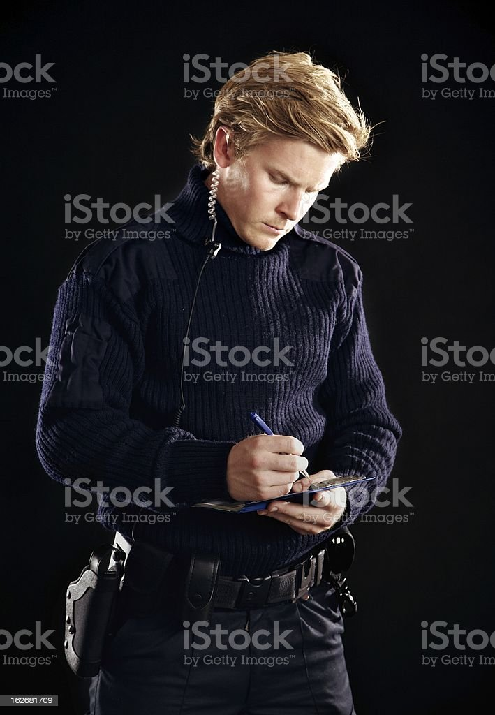 Forensic Detective Writing Evidence Notes stock photo