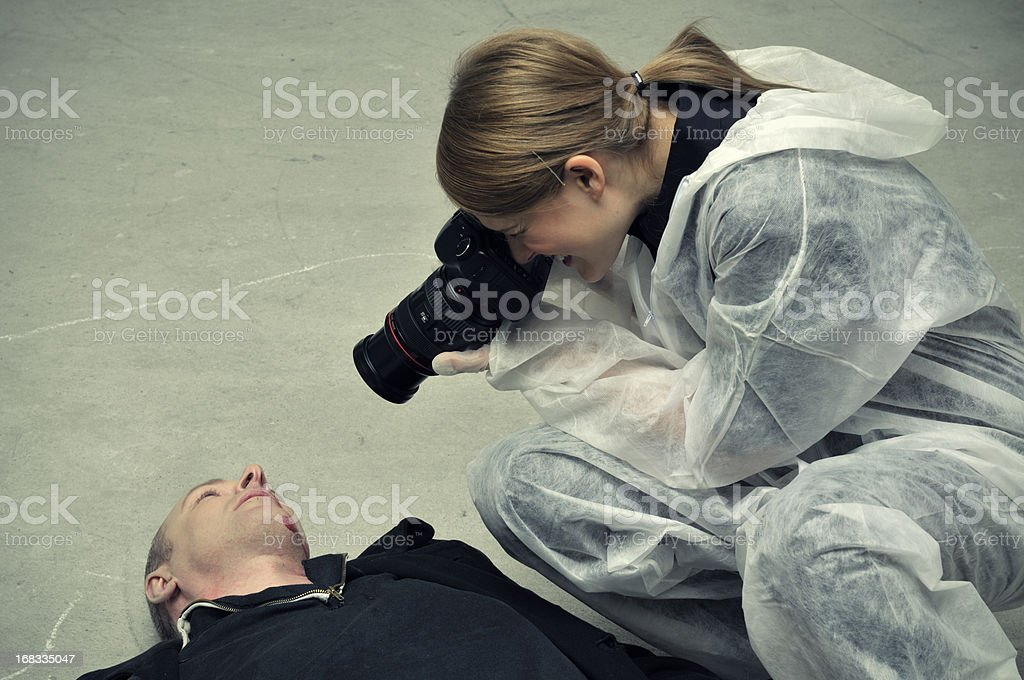 Forensic police photographing dead body stock photo