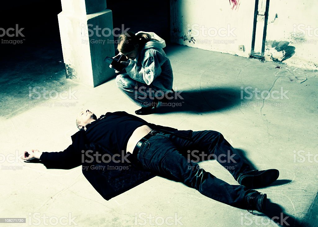 Forensic Scientist photographs crime scene royalty-free stock photo