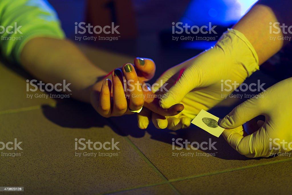 Forensic scientist taking fingerprint stock photo