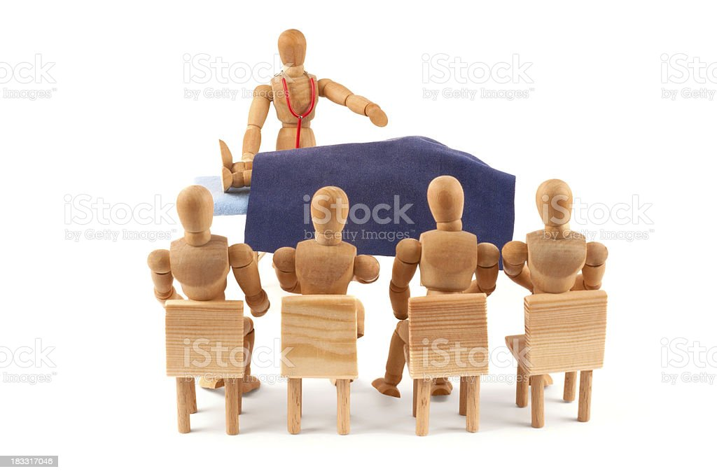 Forensic seminar - wooden mannequin at authopsy auditorium royalty-free stock photo