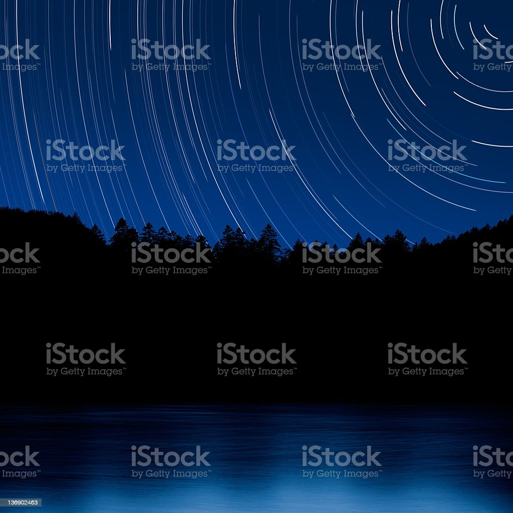 XL forest and lake at night with stars stock photo