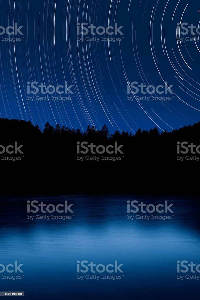 XXL forest and lake with starry sky stock photo