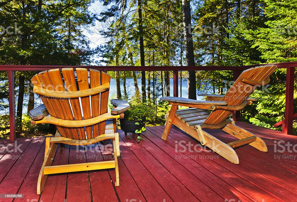 Forest cottage deck and chairs royalty-free stock photo