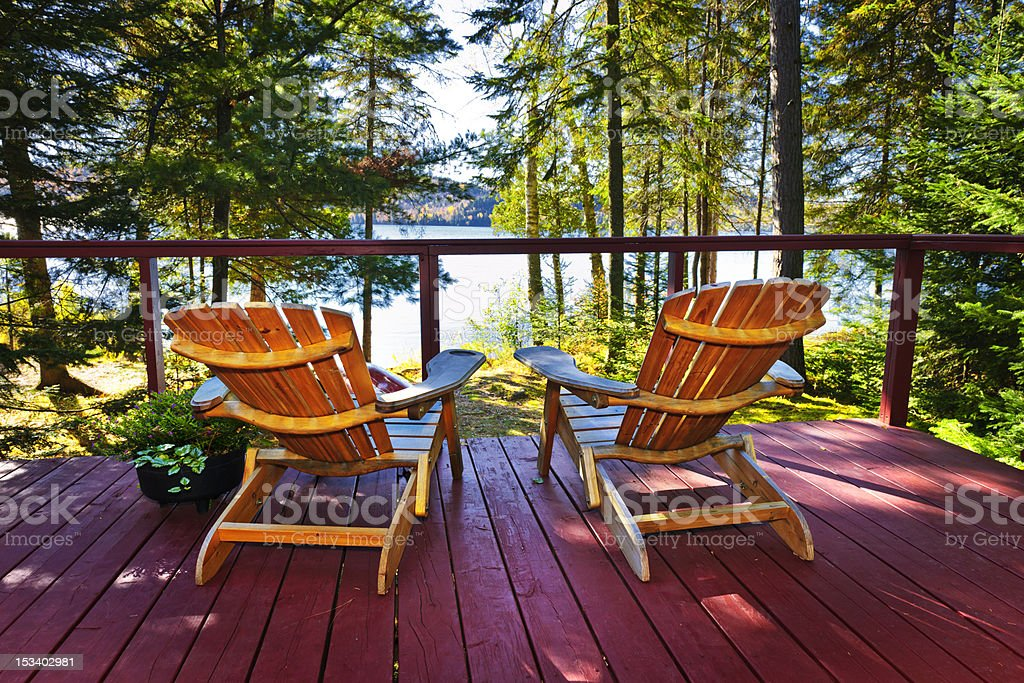Forest cottage deck and chairs stock photo