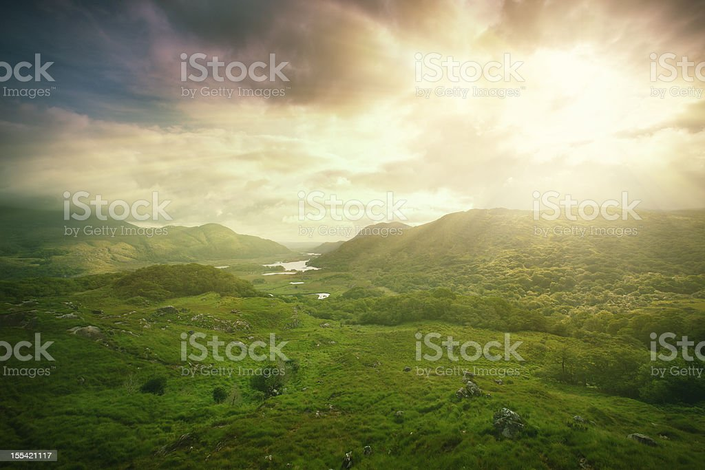 forest covered mountains at sunrise royalty-free stock photo