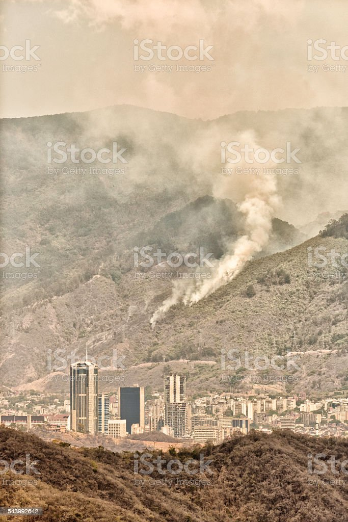 Forest fire or wildfires and smoke pollution on large cities. stock photo