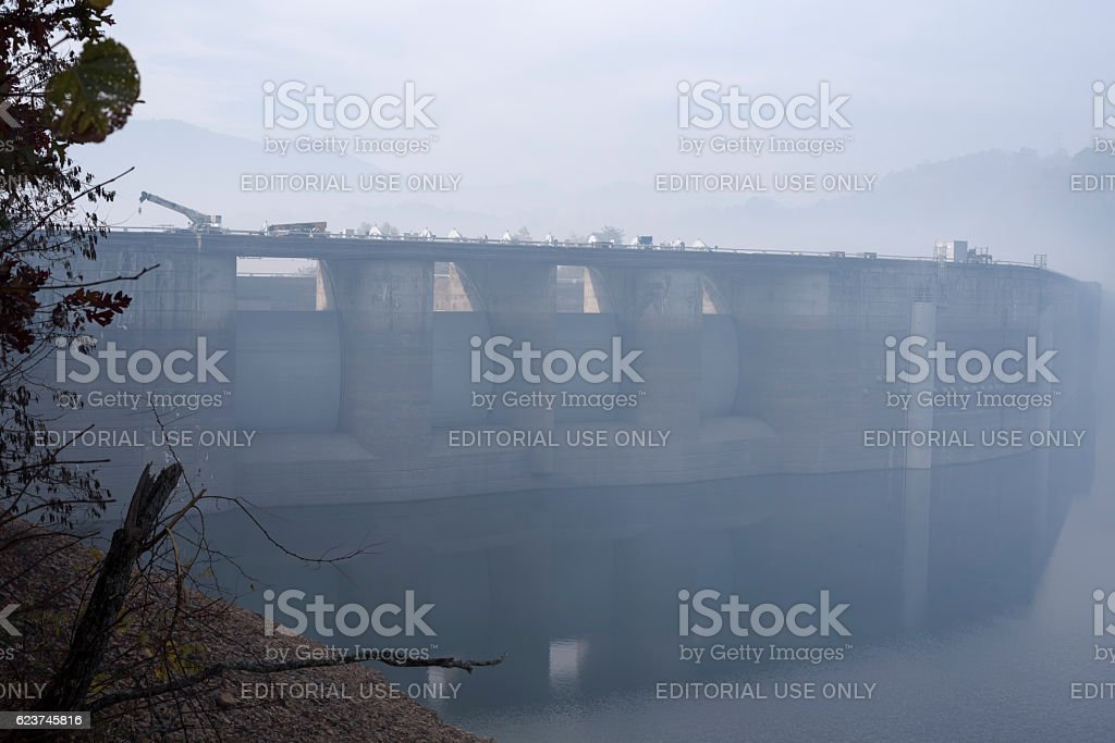 Forest fire smoke and construction equipment at Fontana Dam stock photo