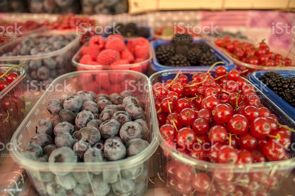 Forest fruits on the market stock photo