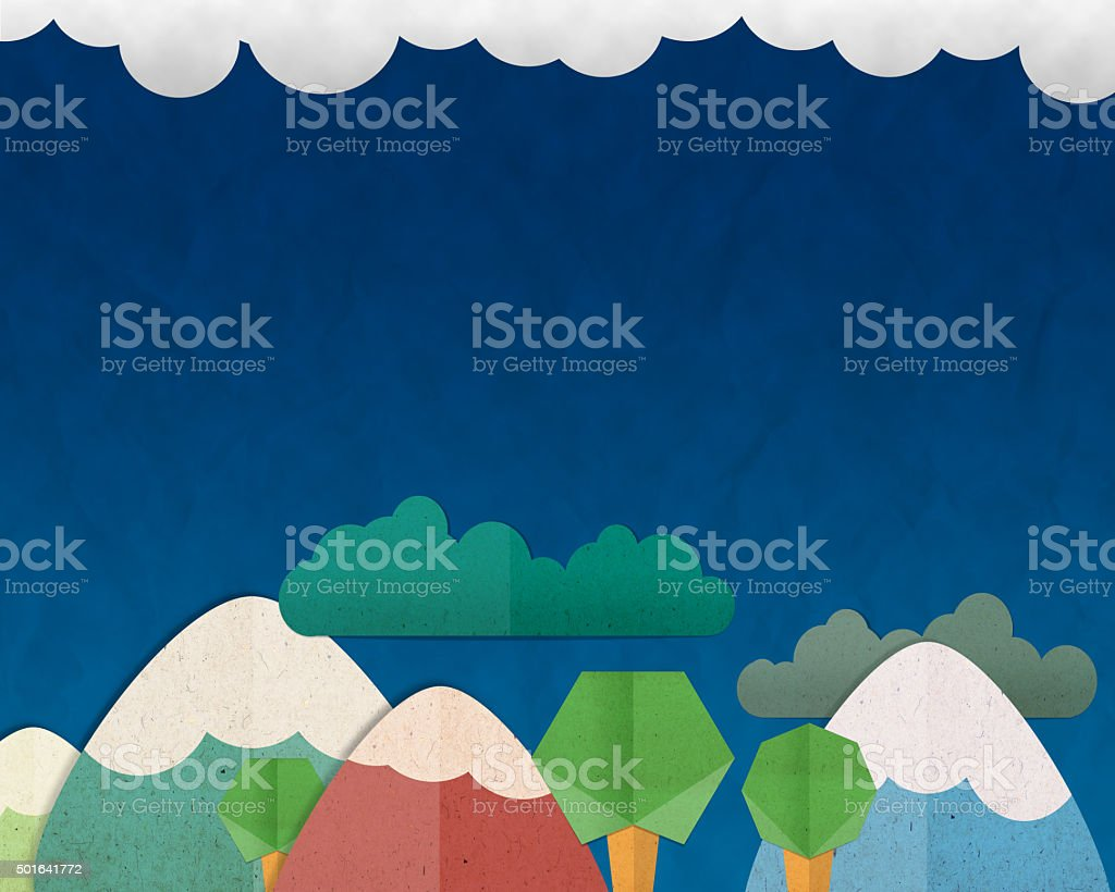Forest Hill and colorful mountain on blue sky background, paper stock photo