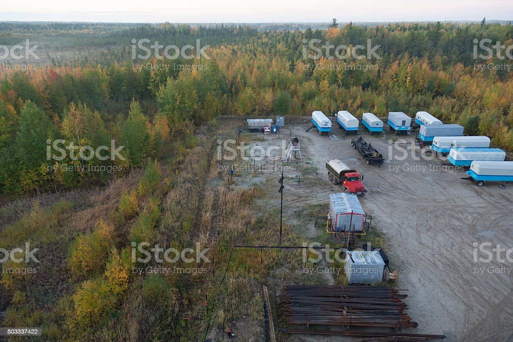 Forest in autumn early morning camp of drilling rig stock photo