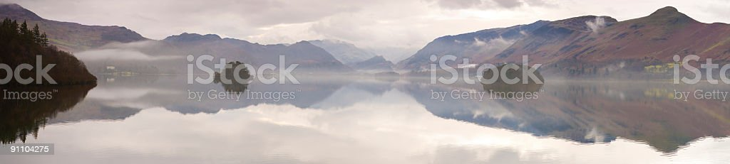 Forest, lake, misty mountains reflected royalty-free stock photo