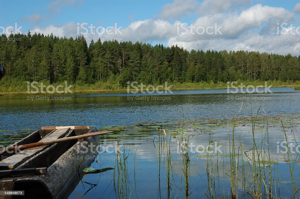 Forest lake with old fishing boat royalty-free stock photo