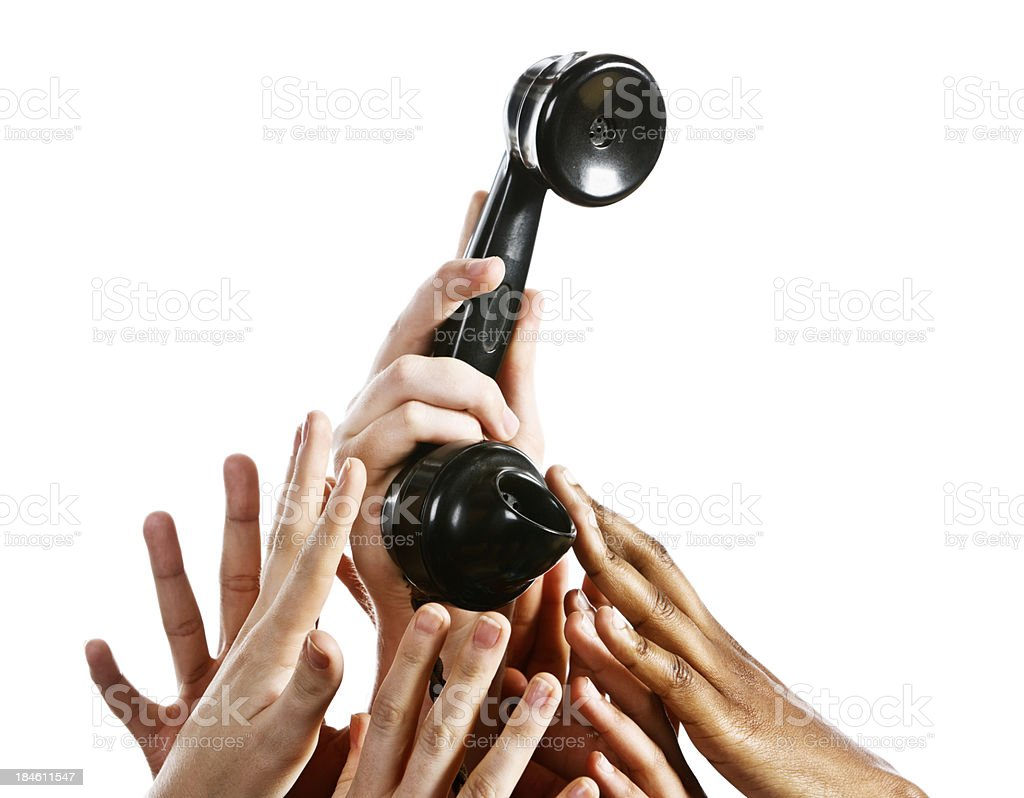 Forest of mixed hands reaching for telephone receiver royalty-free stock photo