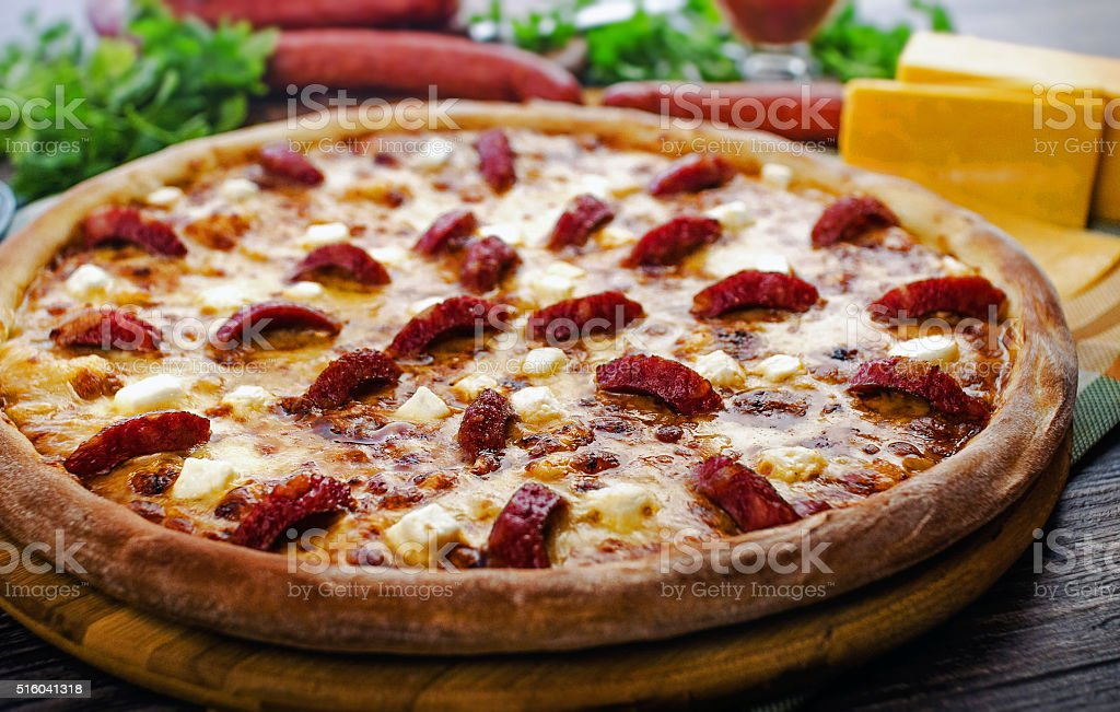 forest pizza with sausage stock photo