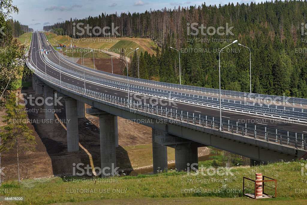 Forest road and unfinished bridge in Leningrad region, Priozersk District. stock photo
