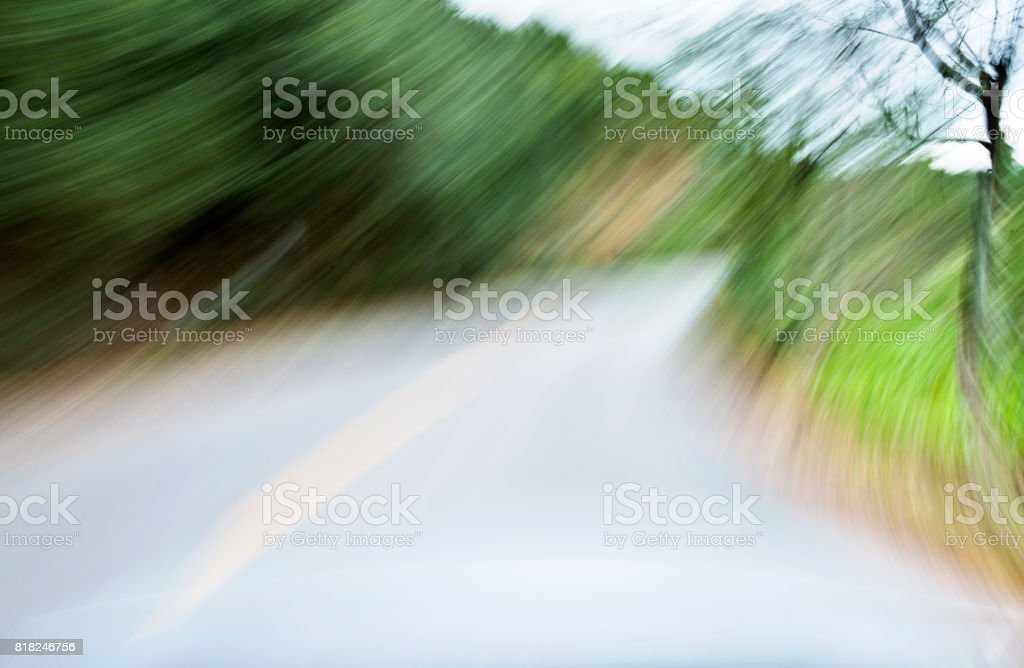 Forest road driving in motion blurred stock photo