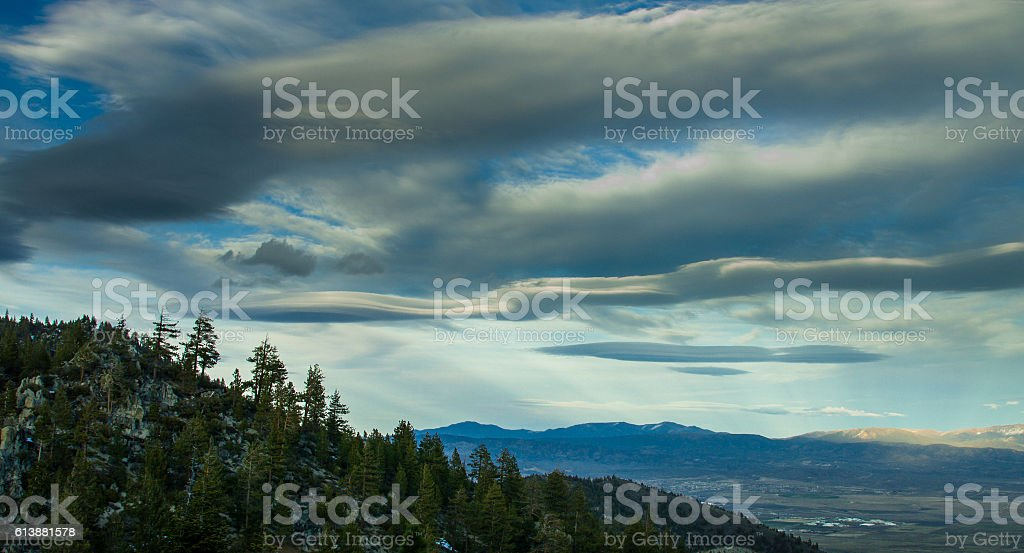 Forested Mountainside at Dusk Over Carson Valley stock photo