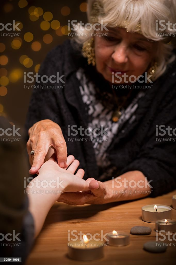 Foretelling future from hand stock photo