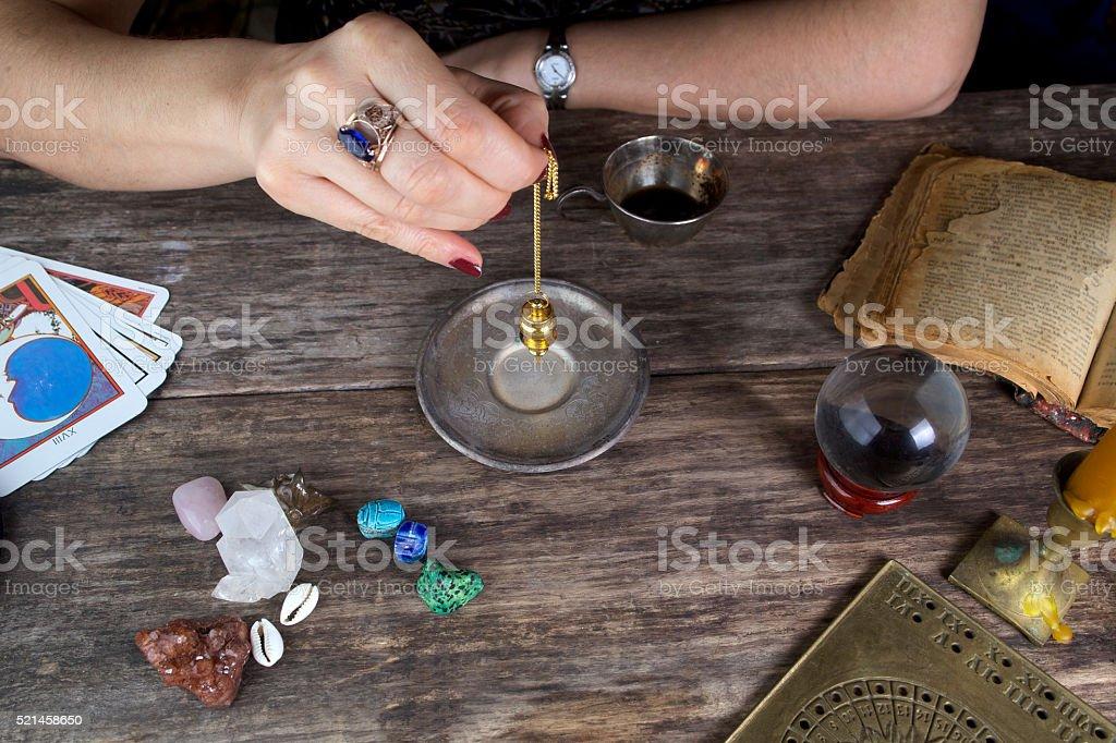 Foretelling the future with pendulum stock photo