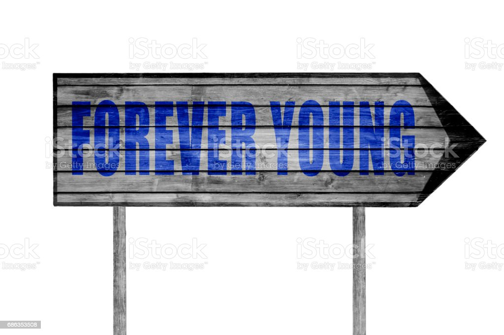Forever Young sign with on beach background stock photo