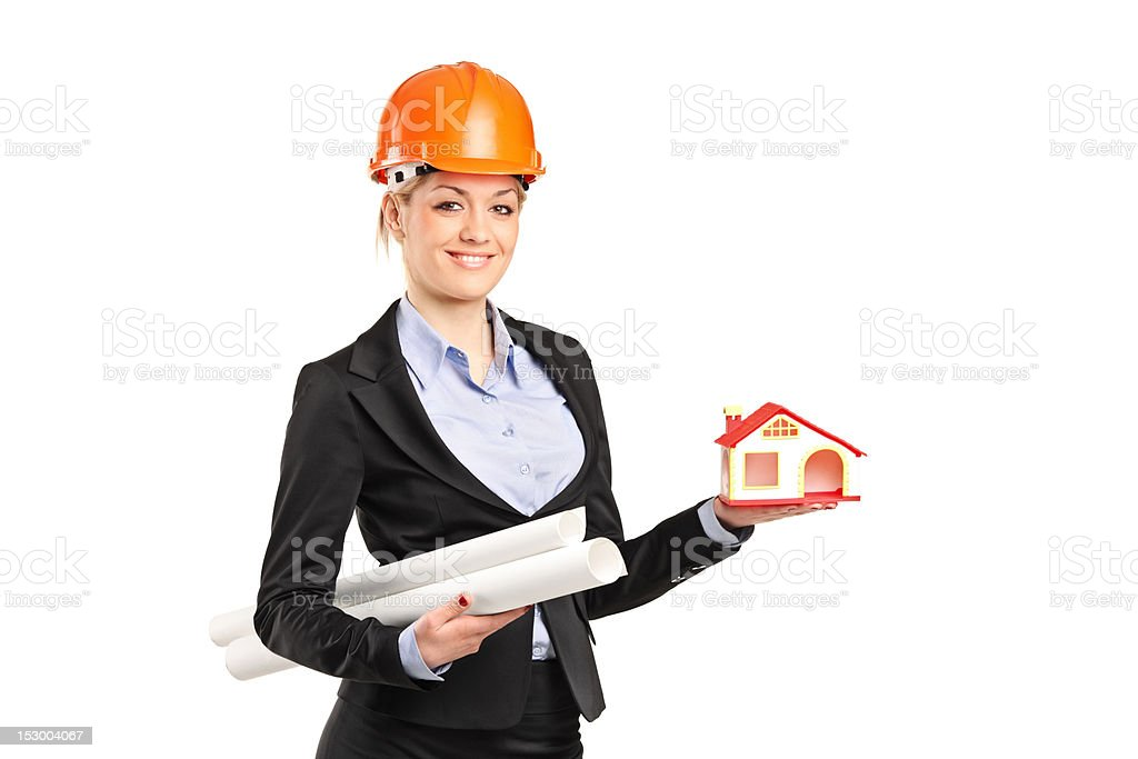 Forewoman holding a model house and blueprints royalty-free stock photo