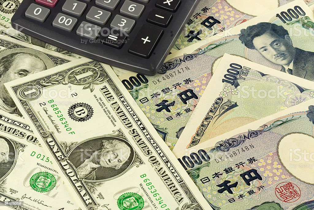 Forex - US and Japanese currency pair with calculator stock photo