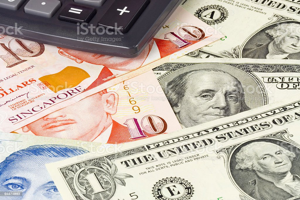 Forex - US and Singapore currency pair with calculator stock photo