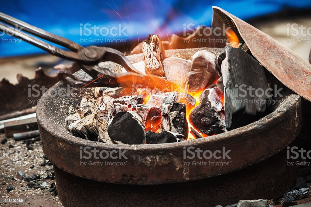 forge a burning forge and tools stock photo