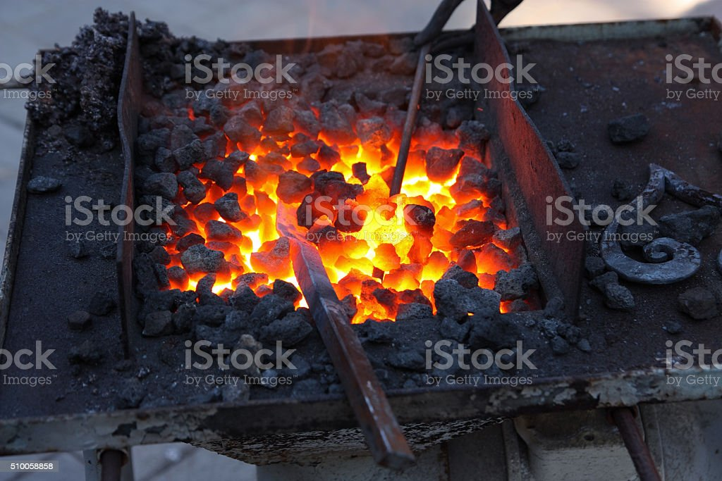 Forge, fiery coals stock photo