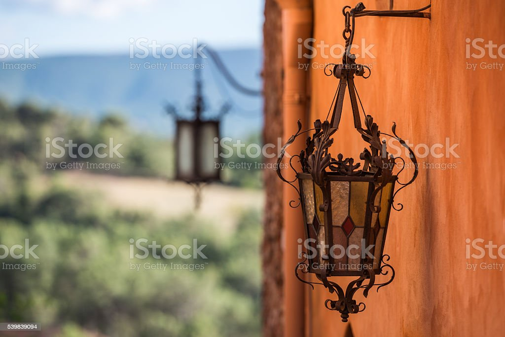 Forged carved lamp as a metallurgy engineering artwork stock photo