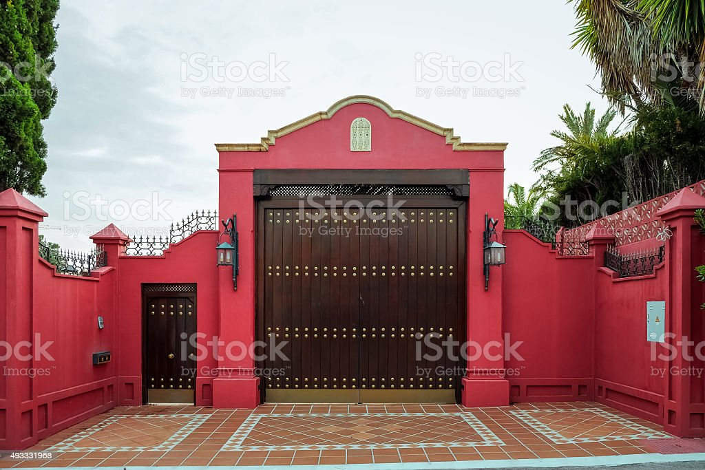 Forged gates and gate. Front of the house. stock photo