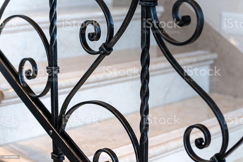 Forged Metal Fence on a Staircase stock photo