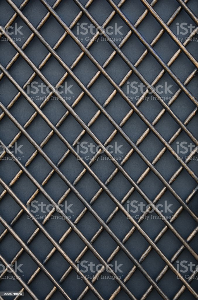 Forged metal lattice on gray background stock photo