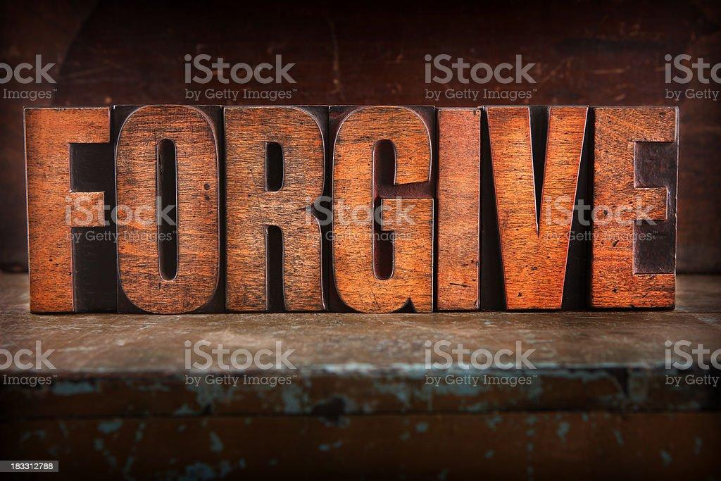 Forgive - Letterpress letters stock photo