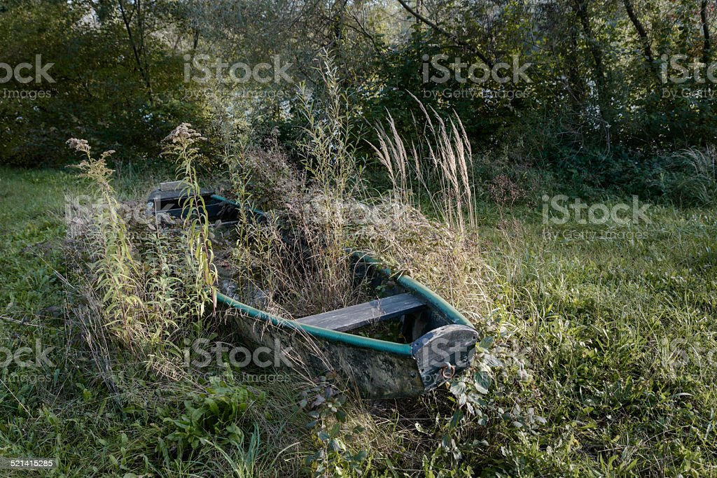 forgotten boat in fall stock photo