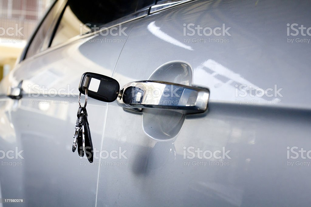 Forgotten car key on the door in parking lots royalty-free stock photo