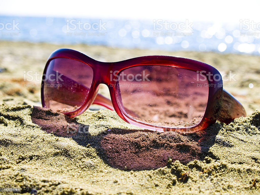 forgotten sunglasses on the beach royalty-free stock photo